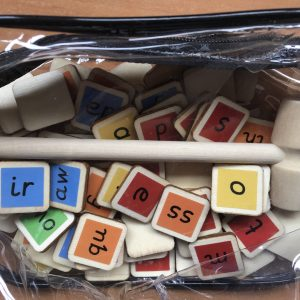 This new toy can be used with our colour coded flash card book to: MAKE, TAP and BLEND hundreds of words. It is fully systematic for phases 2-5 (approximately years reception to year 2). You will receive: 73 colour mapped wooden tiles and a small wooden hammer in a zip up bag.