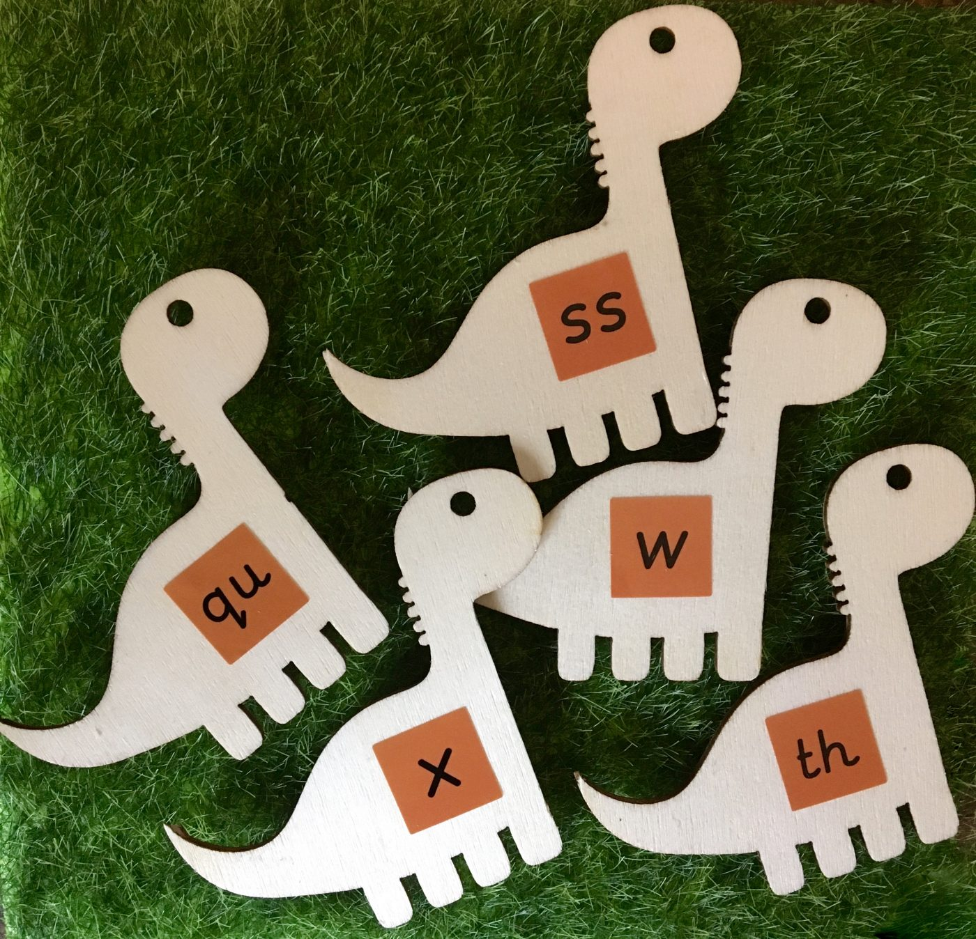 wooden dinosaur toy, phonics letters and sounds